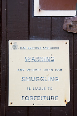 A warning sign to smugglers in Porlock Weir, Somerset, England, United Kingdom, Europe