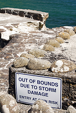 Harbour wall damaged by a severe storm at Lamorna Cove in Cornwall, England, United Kingdom, Europe