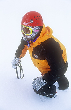 A mountaineer in the Cairngorm mountains in winter, Scotland, United Kingdom, Europe