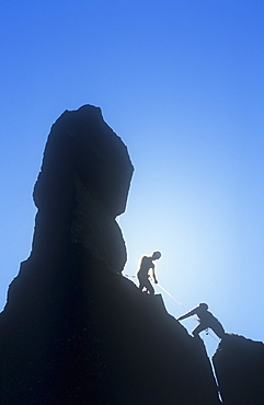 Climbers on Napes Needle, a pinnacle of rock on Great Gable in the Lake District, Cumbria, England, United Kingdom, Europe
