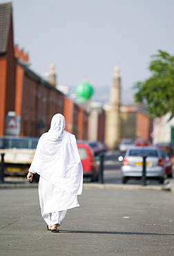 A Muslim woman in a Pakistani area of Blackburn, Lancashire, England, United Kingdom, Europe