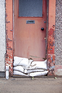 A house door in Workington that was inundated by floodwater, Cumbria, England, United Kingdom, Europe
