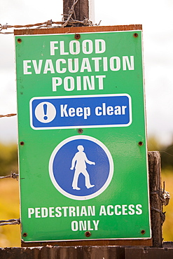 A flood evacuation sign on a caravan park in Towyn, which is very susceptible to coastal flooding, Wales, United Kingdom, Europe