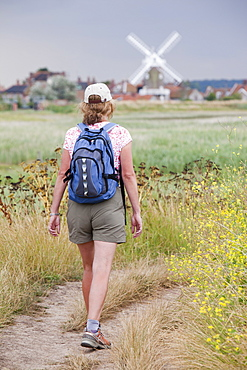 Woman walking on the Pedders Way at Cley Next the Sea, Norfolk, England, United Kingdom, Europe