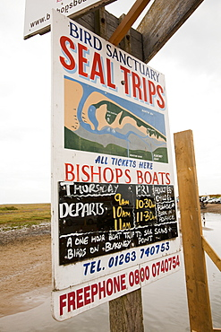 An advert for a seal watching boat trip at Blakeney, in north Norfolk, England, United Kingdom, Europe
