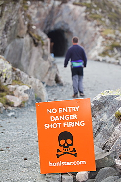 No entry, danger signs at the entrance to Honister Slate Mine, Lake District, Cumbria, England, United Kingdom, Europe