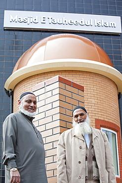 Elderly Pakistani men outside a newly built mosque in Blackburn, Lancashire, England, United Kingdom, Europe