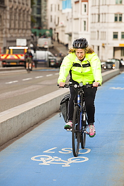 A cyclist on one of the new Cycle Superhighways, in this case the CS7 that goes from Southwark bridge to Tooting, London, England, United Kingdom, Europe
