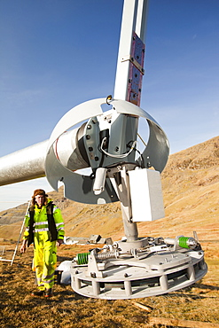 Three wind turbines being constructed behind the Kirkstone Pass Inn on Kirkstone Pass in the Lake District, Cumbria, England, United Kingdom, Europe