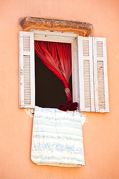 Bedding hanging out of a window in Marrakech, Morocco, North Africa, Africa