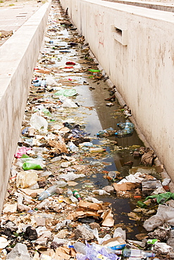 A rubbished contaminated water course in Marrakech, Morocco, North Africa, Africa