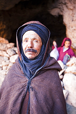 Berber shepherd in cave shelter for goats and sheep in the Anti Atlas mountains of Morocco, North Africa, Africa