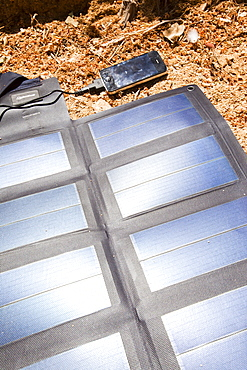 A portable solar mat used to recharge a mobile phone in the Anti Atlas mountains of Morocco, North Africa, Africa