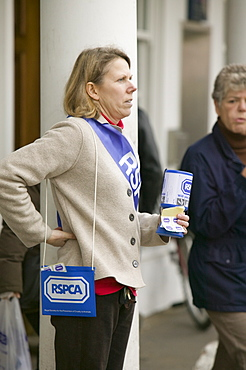 A women charity collector in Newark in Nottinghamshire, England, United Kingdom, Europe