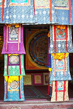 A shop selling traditional Buddhist Thanka paintings in Boudhanath Stupa square, Kathmandu, Nepal, Asia