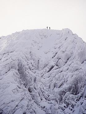 Climbers on Cairn Lochain on the Cairngorm plateau from Coire an Sneachda, Scotland, United Kingdom, Europe