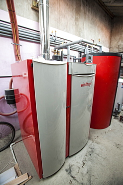 A Windhager biomass boiler that burns carbon neutral wood pellets in a house in Gosforth, Eskdale, Cumbria, England, United Kingdom, Europe
