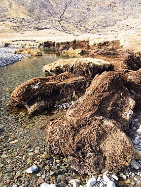 Huge chunks of peat eroded from the side of the Upper Esk by extreme flooding in the Lake District, Cumbria, England, United Kingdom, Europe