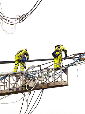 Technicians working to replace old insulators on a pylon in Barrow on Soar, Leicestershire, England, United Kingdom, Europe