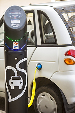 A G Wizz electric car at a pavement recharging station in London, England, United Kingdom, Europe