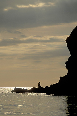 Silhouette of fishermen, Pembrokeshire Coast National Park, West Wales, Uk      (rr)