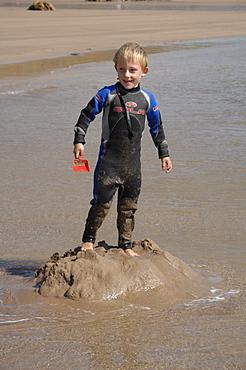 Building sandcastle, Marloes Sands, Pembrokeshire, Wales, UK