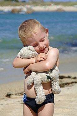 Young boy and teddy, Northern Spain, Mediterranean