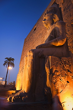 Colossal statues of Rameses II on his thron, Luxor Temple. Luxor, Nile Valley, Egypt, Africa