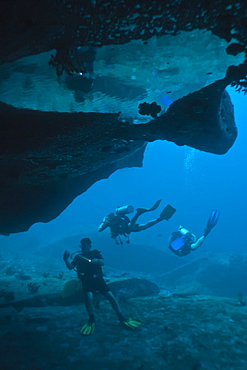 Scuba divers in underwater cave, Southern Thailand, Andaman Sea, Indian Ocean, Asia