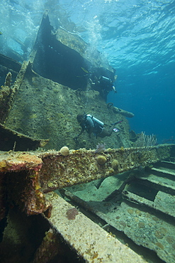 Diver diving on ship wreck in the Turks and Caicos Islands, West Indies, Central America