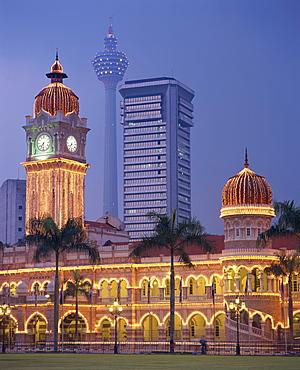The Sultan Abdul Samad Building, formerly the Secretariat, illuminated at dusk, seen from Merdaka Square, Kuala Lumpur, Malaysia, Southeast Asia, Asia
