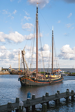 Traditional Dutch merchant ship sailing into Volendam harbour, North Holland Province, The Netherlands (Holland), Europe