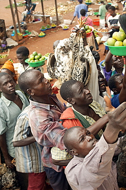 On the road to Kampala, there are numerous opportunities to purchase food, water and even live chickens at various trade spots along the way.  You don't even need to get off the bus. Kampala, Uganda, East Africa