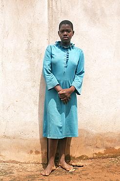 Portrait of a local resident in Gulu Town, Northern Uganda.  She is in her Sunday best. Gulu Town, Uganda, East Africa