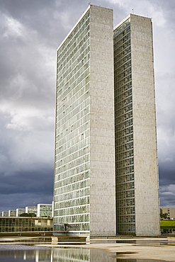 Twin towers of the National Congress designed by Oscar Niemeyer, 1958, at the heart of the Pilot Plan, with Ministries in the background, Brasilia, UNESCO World Heritage Site, Brazil, South America