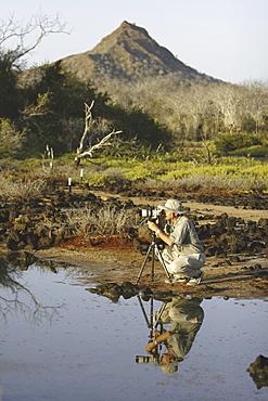Photo class participant Douglas Wilcox taking images in the Galapagos Island Archipeligo, Ecuador. Model release number DW0507.