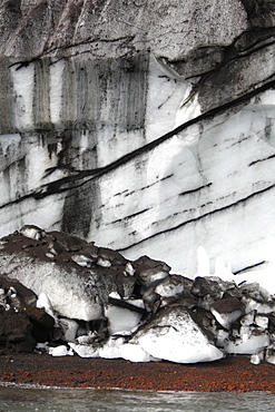 Close up views of glacial ice and ash after the 1969 eruption on Deception Island in Antarctica