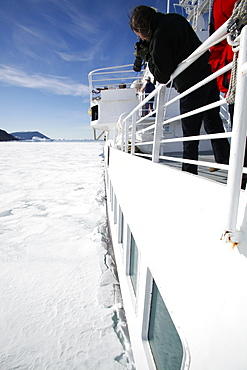 The National Geographic Endeavour breaking through new fast ice around the Antarctic Peninsula.