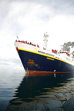 The National Geographic Endeavour pushing through brash ice and small icebergs in the Lemaire Channel near the Antarctic Peninsula.