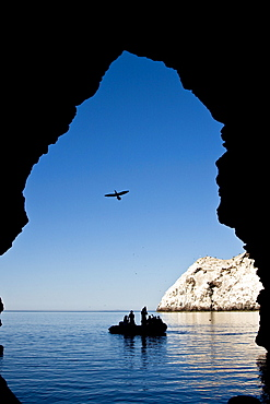 Zodiac approaching a cave at Isla San Pedro Martir in the midriff region of the Gulf of California (Sea of Cortez), Baja California Norte, Mexico.