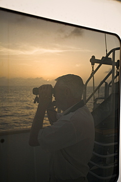 Sunrise or sunset at sea in the Atlantic Ocean from onboard the National Geographic Endeavour crossing the Atlantic Ocean from Lisbon, Portugal to Salvador, Brazil.