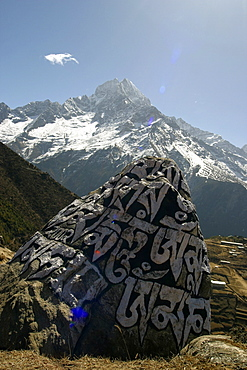 Everest Trail Scenic. Mountains, Prayer Flags, Stone prayer carvings.